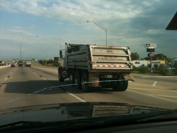 "Saw this truck on 169 in Tulsa, Oklahoma with the intended warning, ""Not *Responsible* for Broken Windshields"" but it read, ""Not Reasonable for Broken Windshields"""