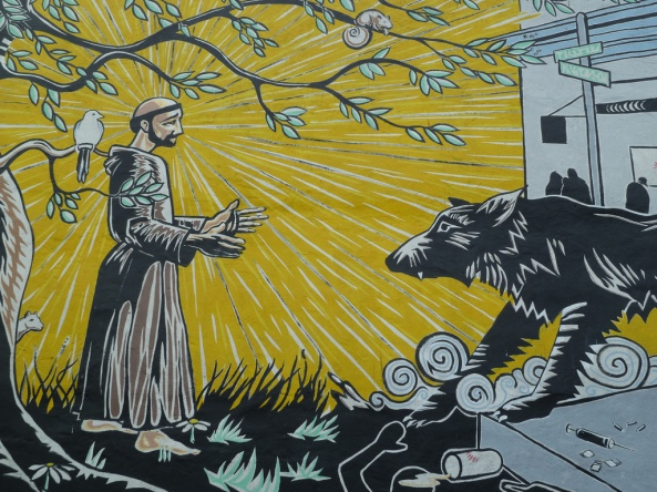 Mural of St. Francis of Assisi and the Wolf of Gubbio at the St. Francis Inn in the Kensington section of Philadelphia, PA.